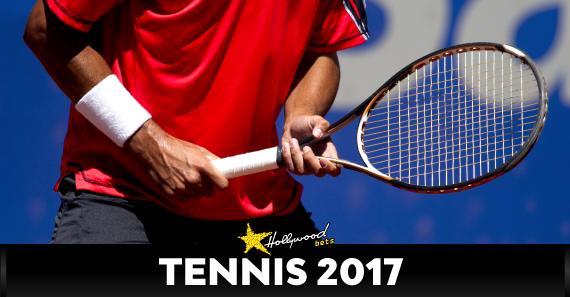 Tennis Player Holds Racquet